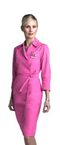Flight attendant Paivi Holiday in a pink uniform for breast cancer awareness.